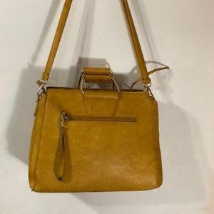 NWOT. Gorgeous yellow all leather handbag.